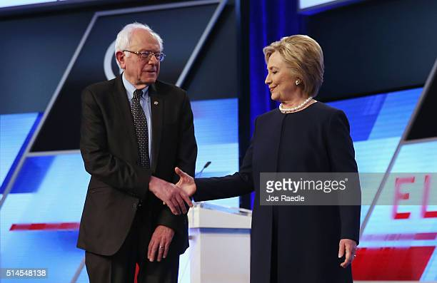 Democratic presidential candidates Senator Bernie Sanders and Democratic presidential candidate Hillary Clinton shake hands before the Univision News...