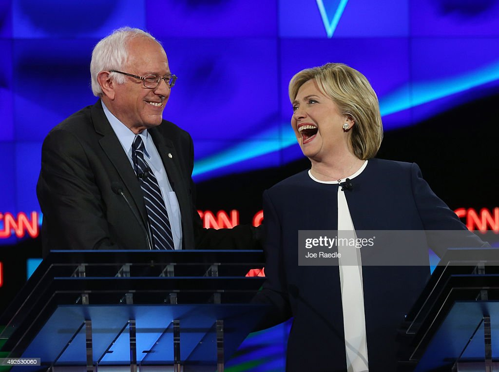 Democratic presidential candidates U.S. Sen. <a gi-track='captionPersonalityLinkClicked' href=/galleries/search?phrase=Bernie+Sanders&family=editorial&specificpeople=2908340 ng-click='$event.stopPropagation()'>Bernie Sanders</a> (I-VT) (L) and <a gi-track='captionPersonalityLinkClicked' href=/galleries/search?phrase=Hillary+Clinton&family=editorial&specificpeople=76480 ng-click='$event.stopPropagation()'>Hillary Clinton</a> take part in a presidential debate sponsored by CNN and Facebook at Wynn Las Vegas on October 13, 2015 in Las Vegas, Nevada. Five Democratic presidential candidates are participating in the party's first presidential debate.