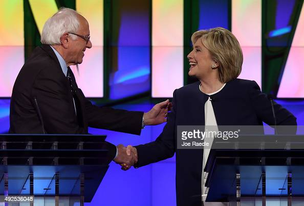 Democratic presidential candidates US Sen Bernie Sanders and Hillary Clinton shake hands at the end of a presidential debate sponsored by CNN and...