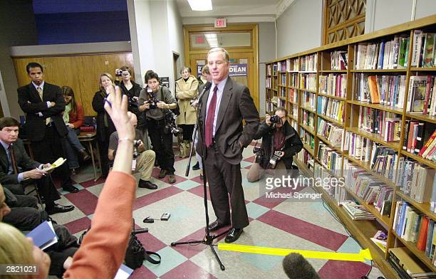 Democratic presidential frontrunner Howard Dean speaks during a news conference following his policy speech at Manchester City Library December 18...