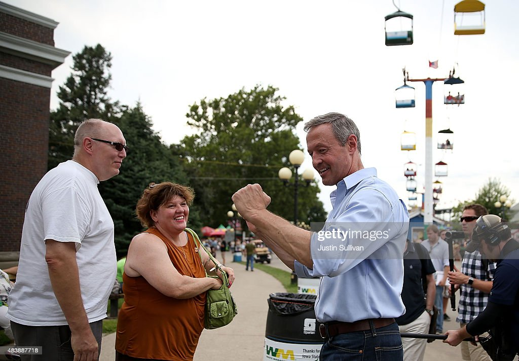 Democratic presidential hopeful and former Maryland Gov. <a gi-track='captionPersonalityLinkClicked' href=/galleries/search?phrase=Martin+O%27Malley&family=editorial&specificpeople=653318 ng-click='$event.stopPropagation()'>Martin O'Malley</a> (R) greets fairgoers during the Iowa State Fair on August 13, 2015 in Des Moines, Iowa. Presidential candidates are addressing attendees at the Iowa State Fair on the Des Moines Register Presidential Soapbox stage. The State Fair runs through August 23.