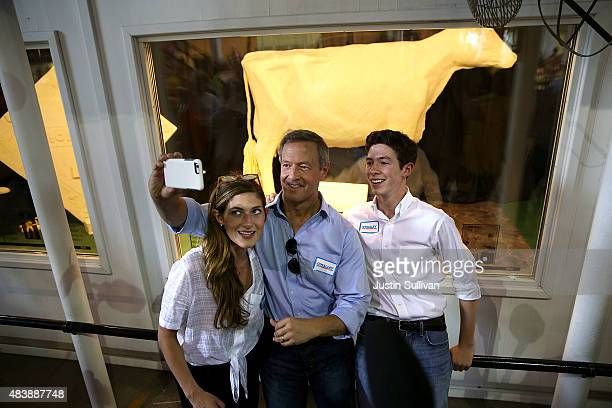 Democratic presidential hopeful and former Maryland Gov Martin O'Malley takes a selfie in front of the Butter Cow with his children Grace and William...