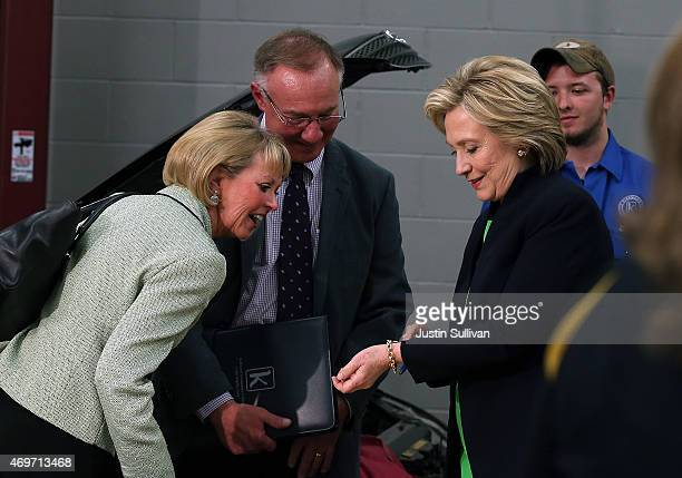 Democratic presidential hopeful and former Secretary of State Hillary Clinton shows her bracelet to attendees at the conclusion of a roundtable...