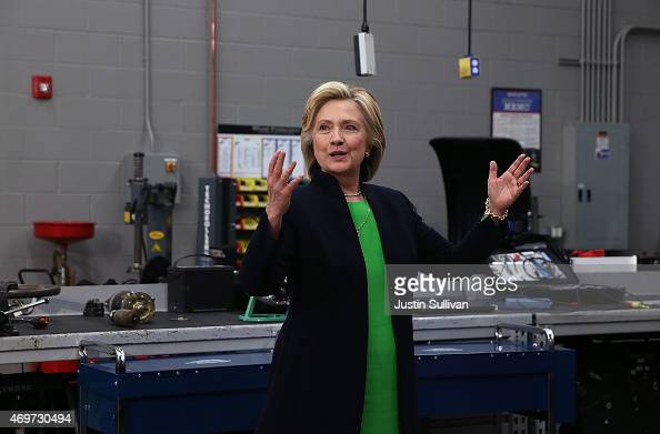 Democratic presidential hopeful and former Secretary of State Hillary Clinton talks with members of the media after a roundtable discussion with...