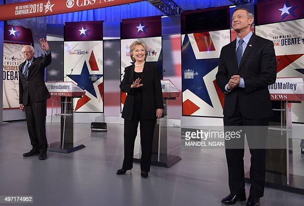 Democratic Presidential hopeful Hillary Clinton and Bernie Sanders wave and Martin OMalley looks on during the second Democratic presidential primary...