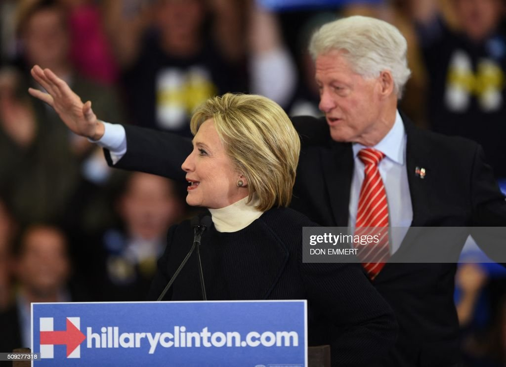 Democratic presidential hopeful Hillary Clinton and former US President Bill Clinton greet the crowd at her primary night party February 9, 2016 at Southern New Hampshire University in Hooksett, New Hampshire. / AFP / Don EMMERT