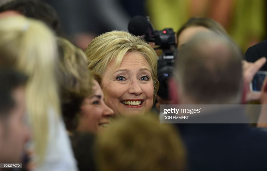Democratic presidential hopeful Hillary Clinton greets the crowd at her primary night party February 9, 2016 at Southern New Hampshire University in Hooksett, New Hampshire. Clinton, who suffered a deflating if expected defeat, put a brave face on the loss and admitted she had some work to do as the campaign moves south. / AFP / Don EMMERT