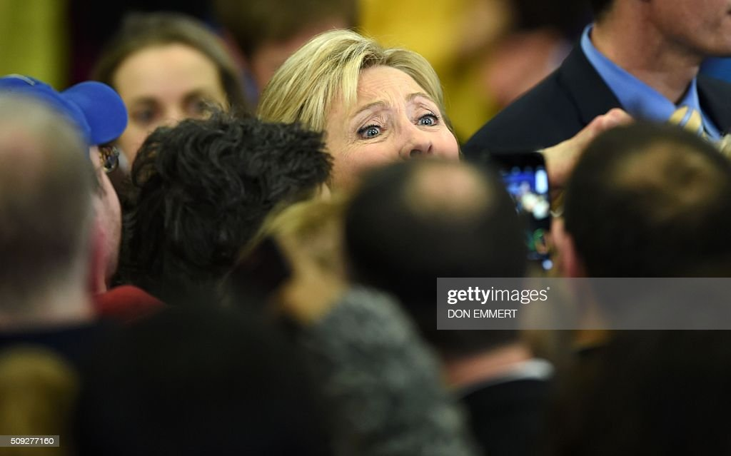 Democratic presidential hopeful Hillary Clinton greets the crowd at her primary night party February 9, 2016 at Southern New Hampshire University in Hooksett, New Hampshire. / AFP / Don EMMERT