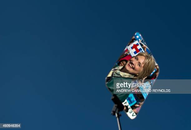 Democratic Presidential hopeful Hillary Clinton is reflected as she arrives for a campaign rally in Alexandria Virginia on October 23 2015 AFP PHOTO/...