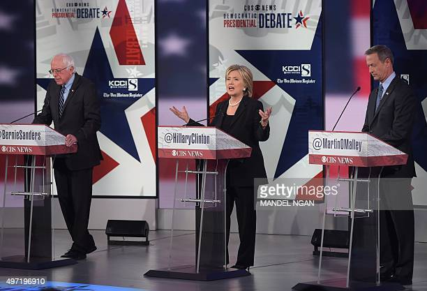 Democratic Presidential hopeful Hillary Clinton speaks as Bernie Sanders and Martin OMalley look on during the second Democratic presidential primary...