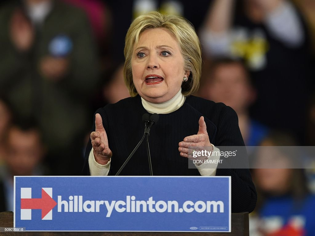 Democratic presidential hopeful Hillary Clinton speaks at her primary night party February 9, 2016 at Southern New Hampshire University in Hooksett, New Hampshire. Clinton, who suffered a deflating if expected defeat to Bernie Sanders, put a brave face on the loss and admitted she had some work to do as the campaign moves south. / AFP / Don EMMERT