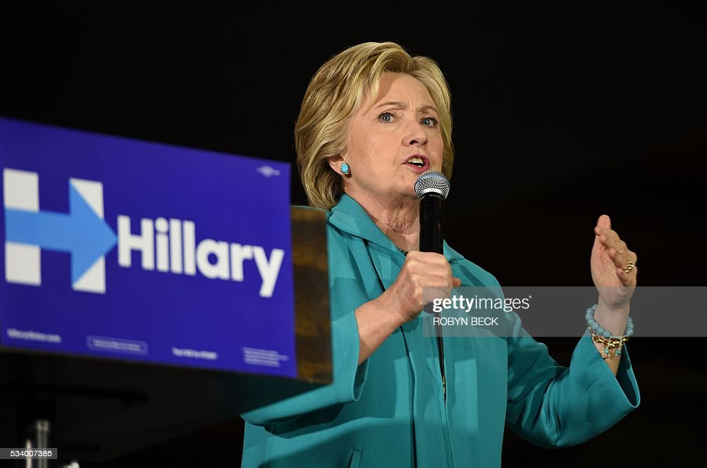 Democratic presidential hopeful Hillary Clinton speaks at the IBEW Local 11 union hall during a campaign event in Commerce, California, May 24, 2016. / AFP / Robyn BECK