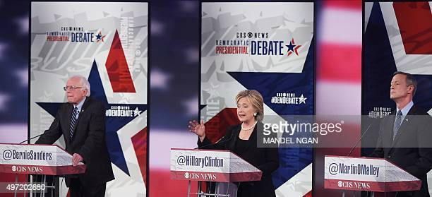 Democratic Presidential hopeful Hillary Clinton speaks flanked by fellow candidates Bernie Sanders and Martin OMalley during the second Democratic...
