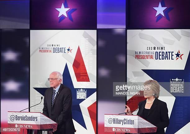 Democratic Presidential hopeful Hillary Clinton speaks next to Bernie Sanders during the second Democratic presidential primary debate in the Sheslow...