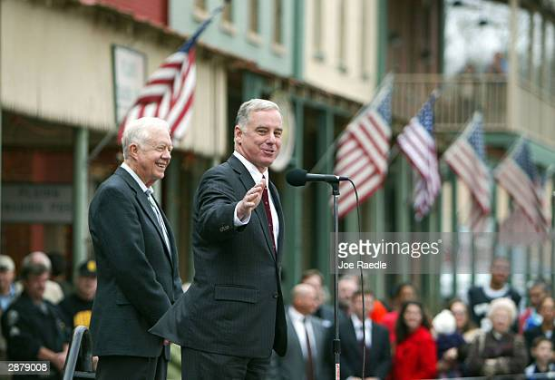 Democratic presidential hopeful Howard Dean gestures as he speaks to supporters while former US President Jimmy Carter stands nearby January 18 2004...