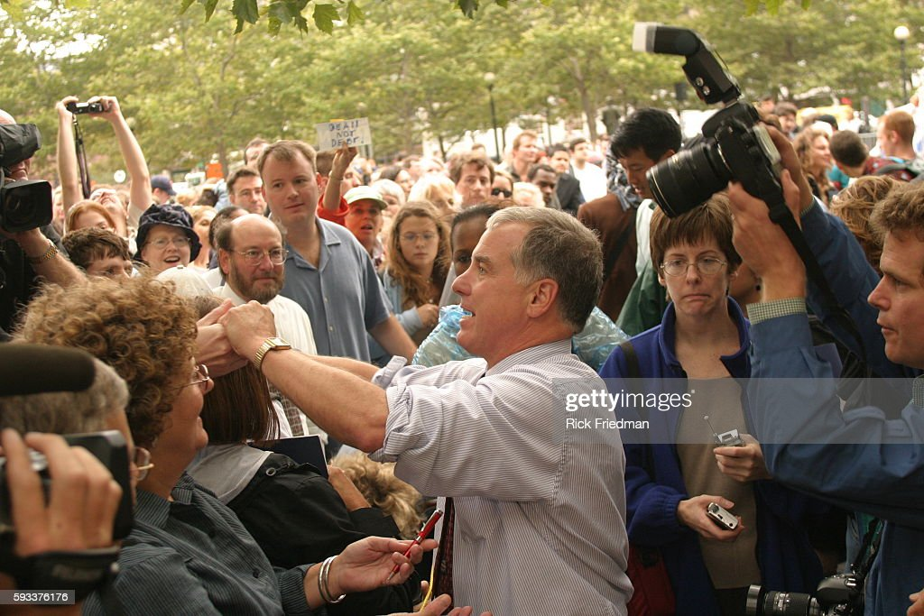 Democratic Presidential hopeful Howard Dean greets some of the 5000 supporters who attended the 'Dean for President' rally in Boston's historic...