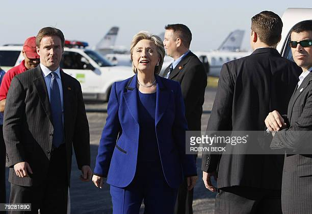 US Democratic presidential hopeful New York Senator Hillary Clinton surrounded by Secret Service agents greets the press as she arrives on the...