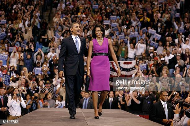 Democratic presidential hopeful Sen Barack Obama and his wife Michelle Obama onstage during a rally at the Xcel Energy Center June 3 2008 in St Paul...