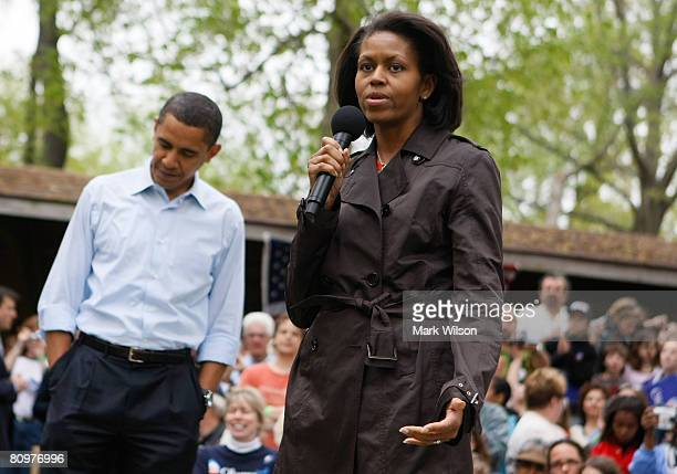 Democratic presidential hopeful Sen Barack Obama listens as his wife Michelle Obama introduces him at a campaign event at the Hamilton Family Picnic...