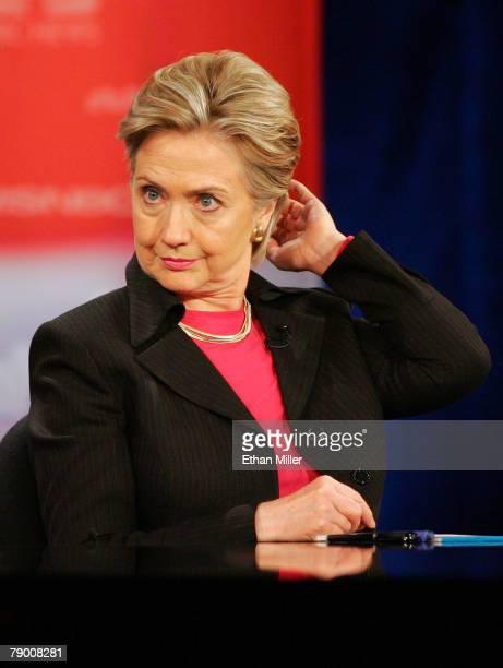 Democratic Presidential hopeful Sen Hillary Clinton adjusts her hair before the start of a Democratic Presidential debate at Cashman Center January...