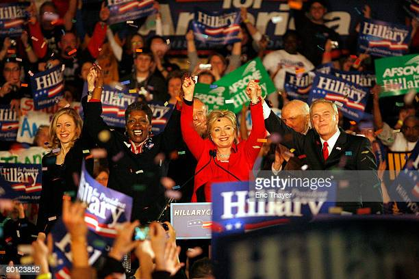 Democratic presidential hopeful Sen Hillary Clinton celebrates during a primary election night party at The Columbus Athenaeum as her daughter...