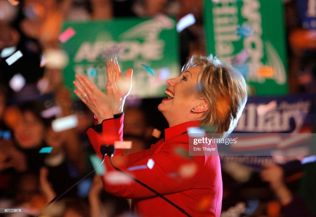 Democratic presidential hopeful Sen Hillary Clinton claps before she speaks during a primary election night party at The Columbus Athenaeum March 4...