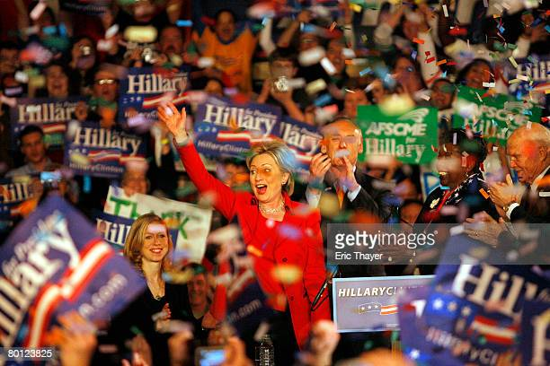 Democratic presidential hopeful Sen Hillary Clinton speaks during a primary election night party at The Columbus Athenaeum as her daughter Chelsea...