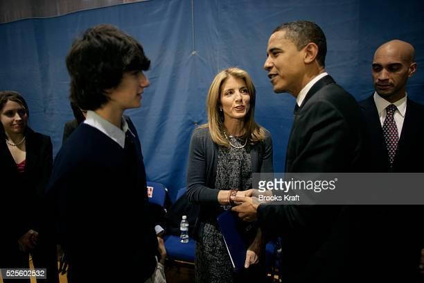 Democratic presidential hopeful Senator Barack Obama greets Caroline Kennedy Schlossberg daughter of the late president John F Kennedy and her son...