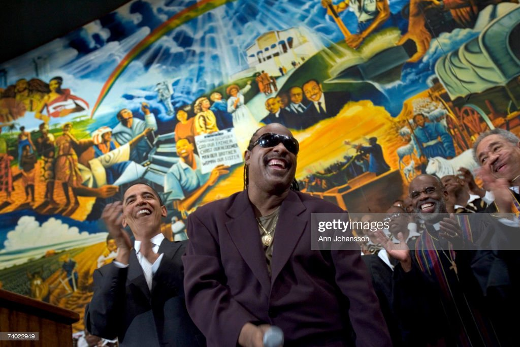 Democratic presidential hopeful Senator Barack Obama (D-IL) (L) is joined by a singing Stevie Wonder during a service commemorating the Los Angeles riots at the First AME Church April 29, 2007 in Los Angeles, California. The Los Angeles riots, which started 15 years ago on April 29, 1992, lasted three days and resulted in 53 deaths.