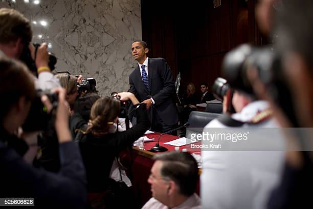 Democratic presidential hopeful Senator Barack Obama is photographed as he arrives to hear testimony from US Commander in Iraq General David Petraeus...