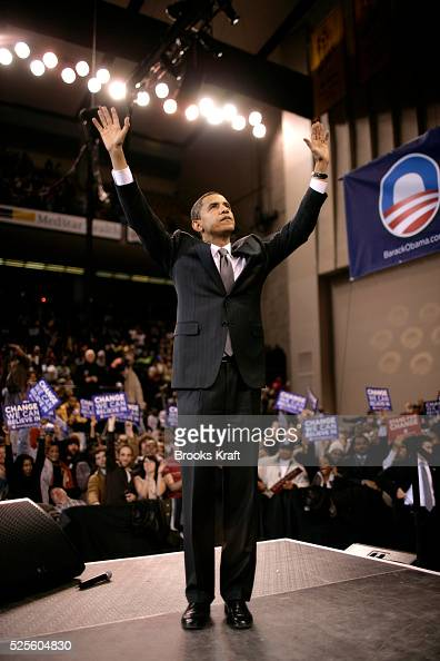 Democratic presidential hopeful Senator Barack Obama raises his arms in response to cheers at a campaign rally at an arena in Baltimore Maryland