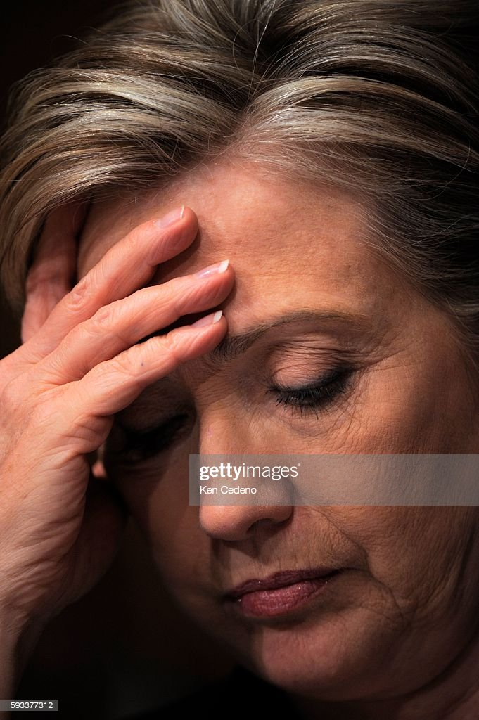 Democratic presidential hopeful Senator Hillary Clinton listens during a hearing held by the Senate Armed Services Committee on Capitol Hill in...