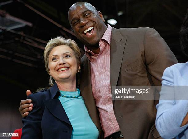 Democratic presidential hopeful US Sen Hillary Clinton hugs former basketball player Earvin 'Magic' Johnson during a rally at California State Los...