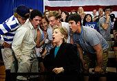 Democratic presidential hopeful US Senator Hillary Clinton yells out a cheer with students Walter Barrows Cody Davis Samantha Ellis Matt Tenero and...