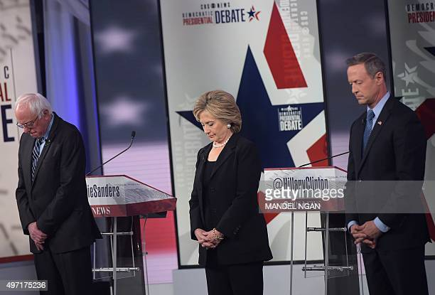 Democratic Presidential hopefuls Bernie Sanders Hillary Clinton and Martin OMalley pause for a moment of silence for the victims of the Paris...