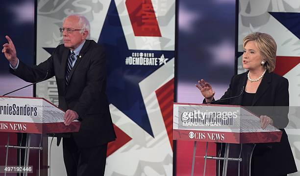 Democratic Presidential hopefuls Hillary Clinton and Bernie Sanders gesture during the second Democratic presidential primary debate in the Sheslow...