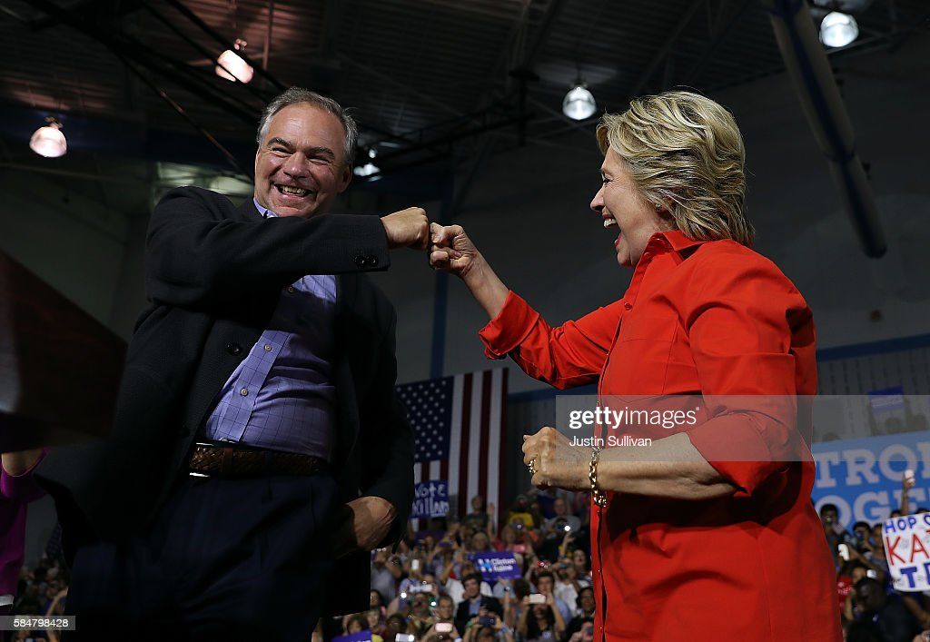 Democratic presidential nominee former Secretary of State Hillary Clinton and democratic vice presidential nominee US Sen Tim Kaine fist bump during...