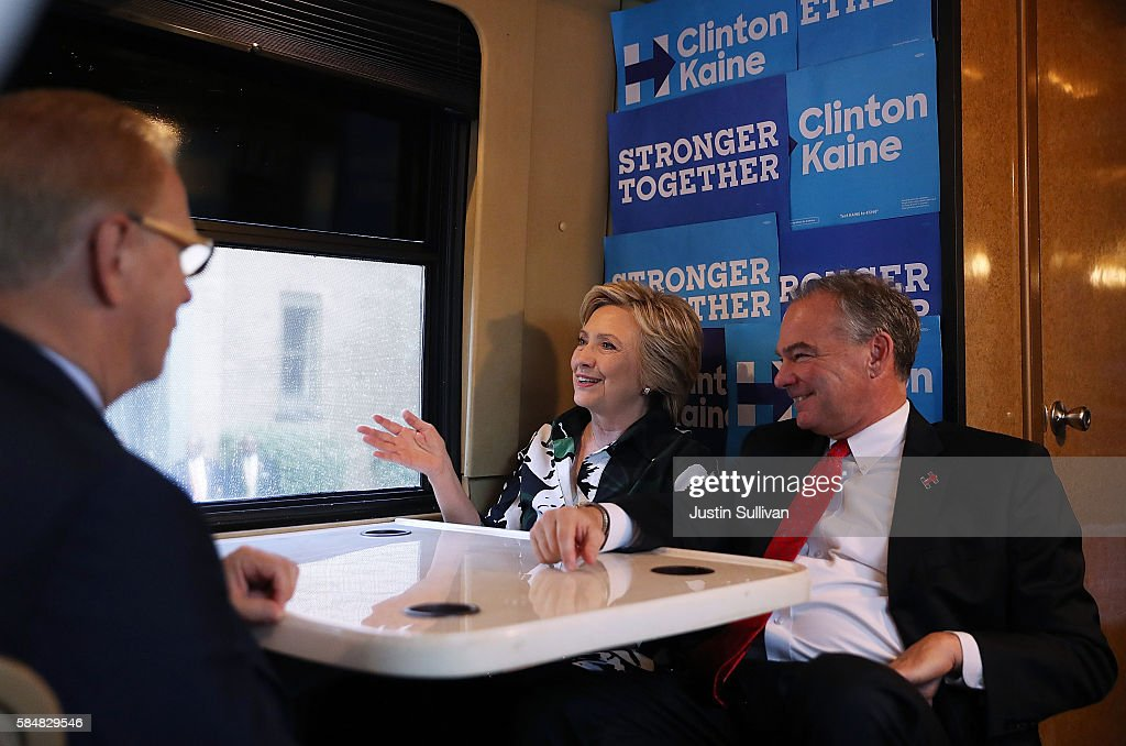 Democratic presidential nominee former Secretary of State Hillary Clinton and democratic vice presidential nominee US Sen Tim Kaine sit on their...
