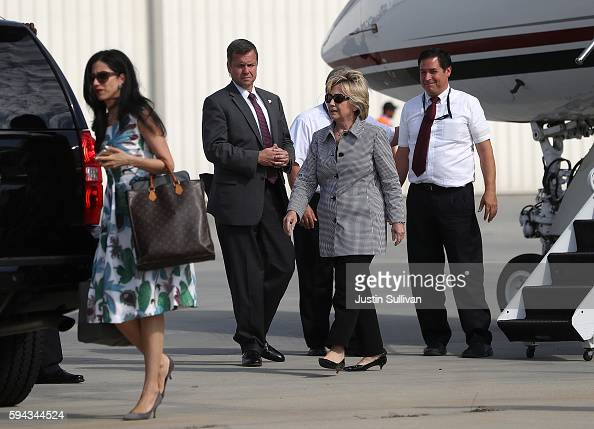 Democratic presidential nominee former Secretary of State Hillary Clinton walks off of her plane at Van Nuys Airport on August 22 2016 in Van Nuys...