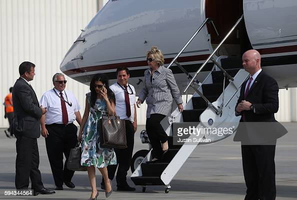 Democratic presidential nominee former Secretary of State Hillary Clinton walks off of her plane with aide Huma Abedin at Van Nuys Airport on August...