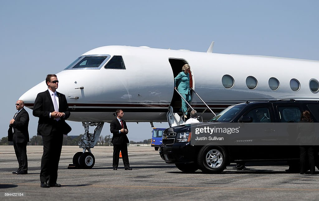 Democratic presidential nominee former Secretary of State Hillary Clinton walks off of her plane at John Wayne Orange County Airport on August 23...