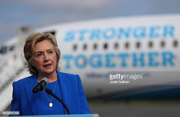 Democratic presidential nominee former Secretary of State Hillary Clinton speaks to reporters on the tarmac at Westchester County Airport on...