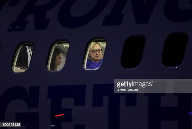 Democratic presidential nominee former Secretary of State Hillary Clinton and aide Huma Abedin are seen through the windows of the Clinton's campaign...