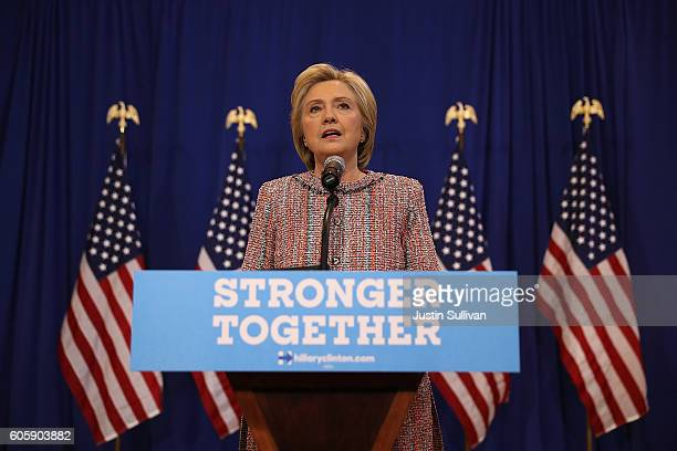 Democratic presidential nominee former Secretary of State Hillary Clinton speaks to reporters during a press availability following a campaign rally...