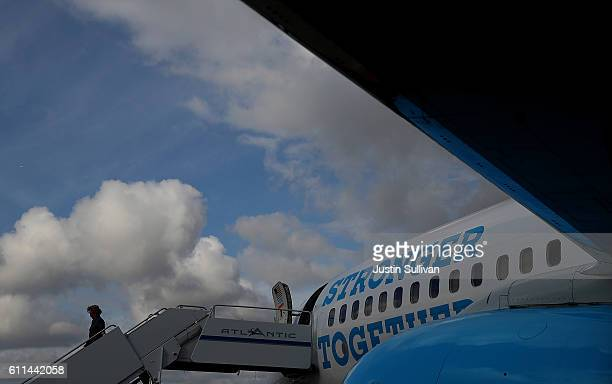 Democratic presidential nominee former Secretary of State Hillary Clinton walks off of her campaign plane at Chicago Midway Airport on September 29...