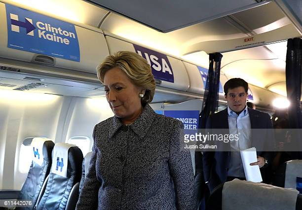 Democratic presidential nominee former Secretary of State Hillary Clinton returns to her cabin after speaking to reporters aboard her campaign plane...