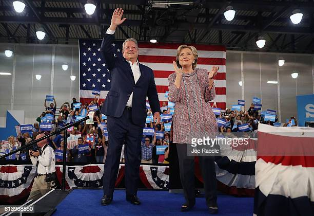Democratic presidential nominee former Secretary of State Hillary Clinton and former Vice President Al Gore campaign together at the Miami Dade...
