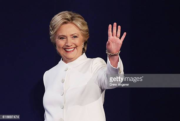 Democratic presidential nominee former Secretary of State Hillary Clinton waves to the crowd as she walks on the stage during the third US...