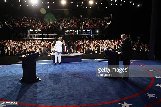 Democratic presidential nominee former Secretary of State Hillary Clinton shakes hands with Fox News anchor and moderator Chris Wallace as Republican...