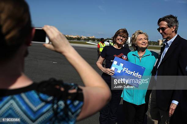 Democratic presidential nominee former Secretary of State Hillary Clinton greets supporters on the tarmac as she arrives at Daytona Beach Airport on...